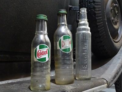 Lot 3 - Three glass oil bottles